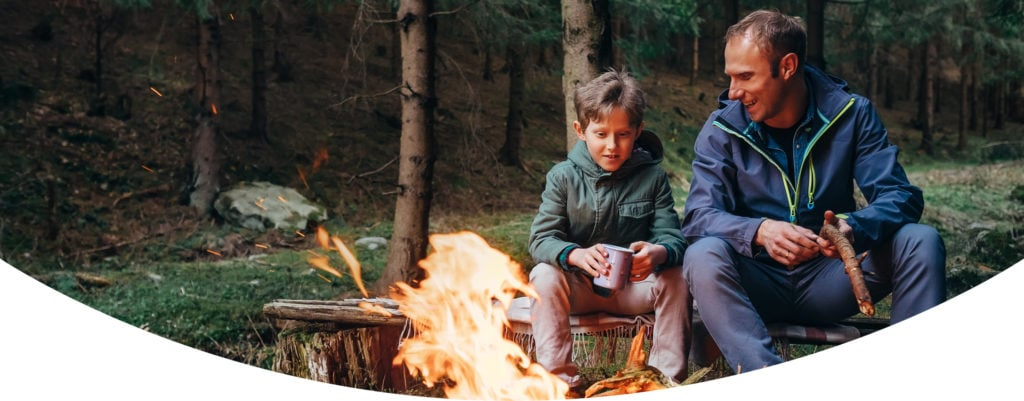 A father camping with his son.