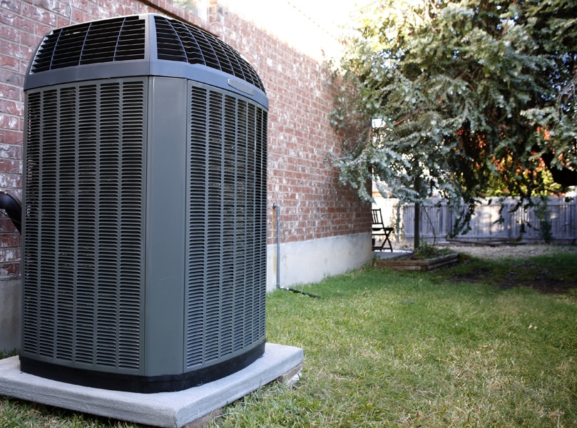 Air Conditioner in backyard of home