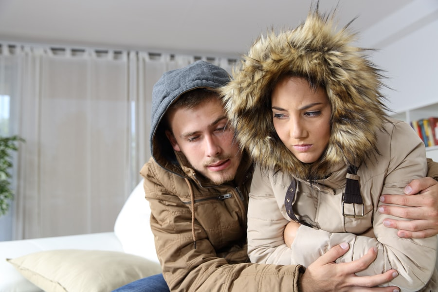 Cold couple in home trying to stay warm and figure out why their furnace isn't heating their entire home.